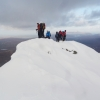 Reaching the summit of Sgurr a Bhasteir (898m) with the Storr in the background