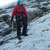 Awkward descent over the icy slabs
